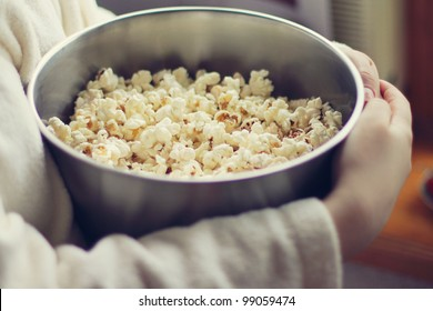 popcorn in metal bowl in the hands