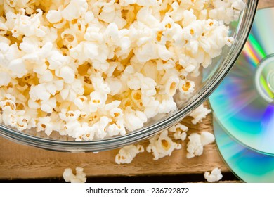 Popcorn And A Movie - This is a shot of a bowl of popcorn next to a DVD.