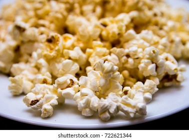 Popcorn on white plate.