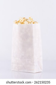 Popcorn in paper bag isolated on white background