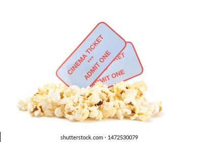 Popcorn pile with tickets isolated on white background, close up