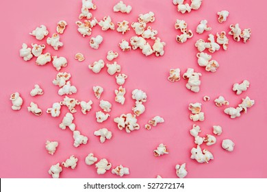 Popcorn  in pink background .top view