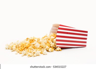 Popcorn in red and white cardboard box is shaking
