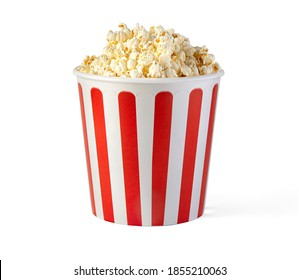 Popcorn in red and white striped cardboard bucket isolated on white background with clipping path