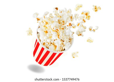 Popcorn with salt on a white isolated background. toning. selective focus