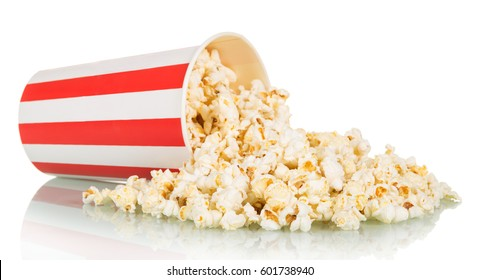 Popcorn was scattered from a large striped box, isolated on white background.