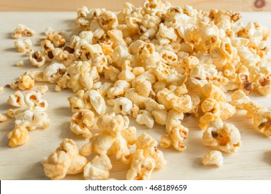 Popcorn scattered on the wooden floor