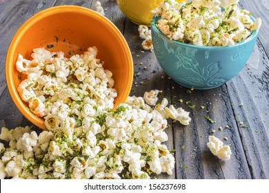 Popcorn sprinkled with furikake, a japanese seasoning made of sesame seeds, salt, sugar and seaweed, common in Hawaii
