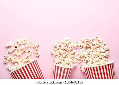 Popcorn in striped buckets on pink background