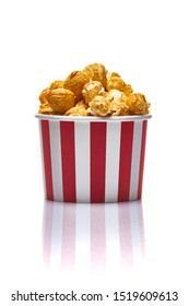 Popcorn in striped paper box on white background  isolated stock photo