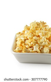 popcorn in white bowl with caramel