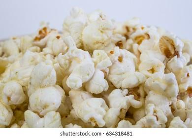 Popcorn in white bowl closeup image white background
