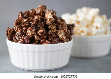 Popcorn in  white bowls on a gray background. Soft focus.