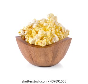 Popcorn in wooden bowl on the white background