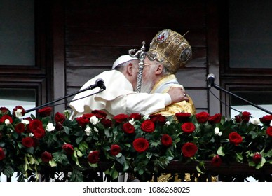 Pope Francis, left, and Ecumenical Patriarch Bartholomew I hug each other after a holy liturgy at the Patriarchal Church of St. George in Istanbul, Sunday, Nov. 30, 2014.