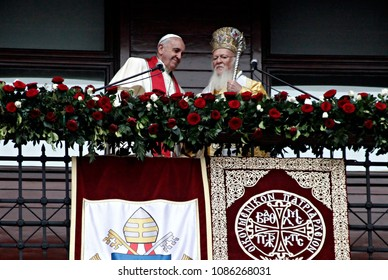 Pope Francis, left, and Ecumenical Patriarch Bartholomew I hold their hands and wave to faithful after a holy liturgy at the Patriarchal Church of St. George in Istanbul, Sunday, Nov. 30, 2014.