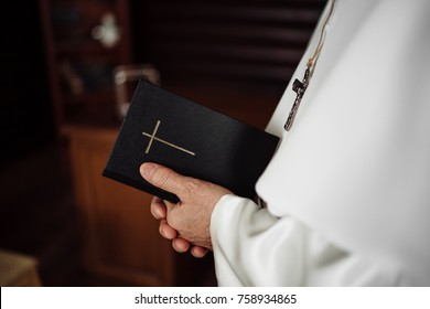 Pope holding a Bible