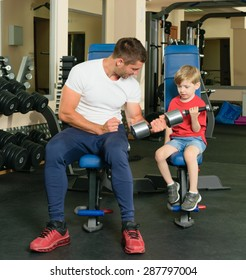 Pope shows little son how to lift weights in the gym
