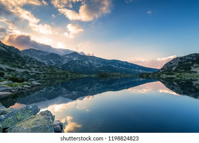 Popovo lake at Bezbog, Bulgaria and mountains reflection at summer.