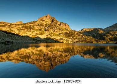 Popovo Lake and Jangal mountain in Pirin National Park,Bulgaria at sunrise.