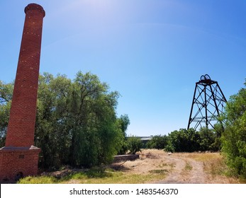 Poppet head at historical mine sight on a bright blue day