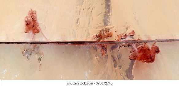poppies in the desert,abstract photography of the deserts of Africa from the air, bird's eye view, abstract expressionism, contemporary art, optical illusions,