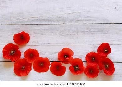 Poppies flowers on wooden background