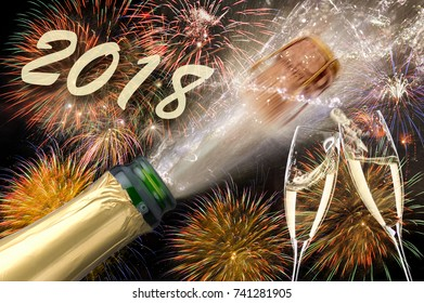popping champagne and fireworks at silvester and new years eve 2018