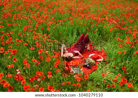 Poppy remembrance anzac day poppy flower stock photo edit now poppy remembrance or anzac day poppy flower field with woman writing mightylinksfo