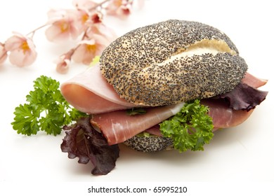 Poppy roll coated with hams lettuce leaf
