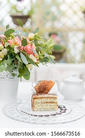 Poppy seed cake on a white table in the garden