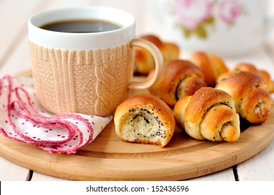 Poppy seed rugelach (croissant) with a cup of coffee (tea)