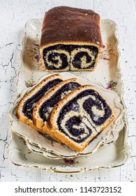 Poppy seed sweet bread or cozonac on a white table board
