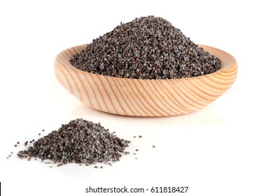 poppy seeds in a wooden spoon isolated on white background. Selective focus