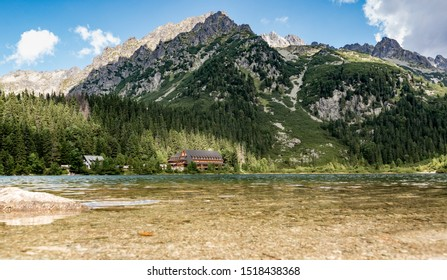 Poprad lake with hotel and cottage in distance. Low angle view near water surface. September, end of summer, sunny day. National park High Tatras, Slovakia, Europe