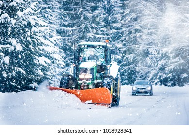 Poprad ,Slovakia, 10/1/2018, John Deere, Snow plow truck clearing road after winter snowstorm blizzard for vehicle access