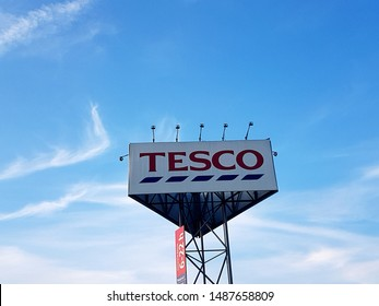 POPRAD, SLOVAKIA - july 16, 2019: Large TESCO Signboard on a blue sky. Tesco PLC is a big British multinational grocery and general merchandise. Over 3400 stores in the world.