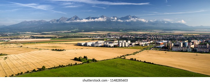 POPRAD, SLOVAKIA - JULY 28: Centre of city Poprad and High Tatras mountains from above on July 28, 2018 in Poprad