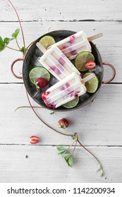 Popsicles made with strawberries and lime