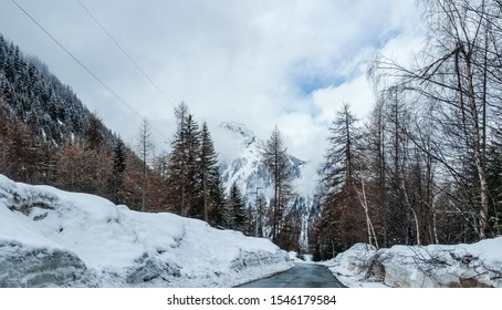 Popular alpine ski resort in winter at the foot of Mont Blanc in Courmayeur, Aosta valley, Italy. Known for SkyWay Monte Bianco cable car, with views of mountains like the Matterhorn and Monte Rosa.