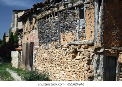 Popular architecture in Soria, Spain, Calatañazor, facades of branches with mud, adobe,