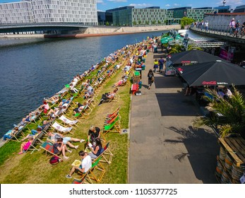 Popular beach club at River Spree in Berlin on a hot summer day - BERLIN / GERMANY - MAY 21, 2018