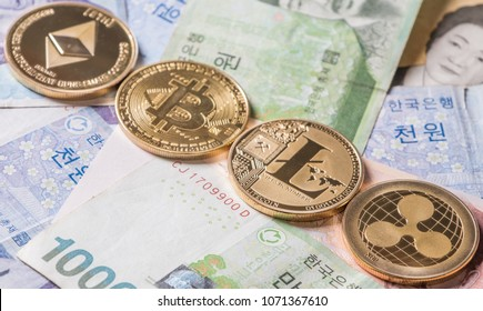 Popular crypto currencies Ethereum, Litecoin, Ripple coin and Bitcoin on South Korean won bank notes