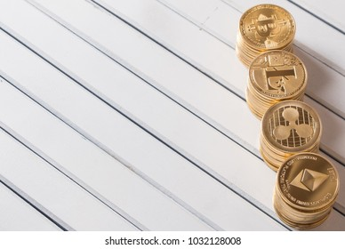 Popular cryptocurrency bitcoin, litecoin, ripple and ethereum over wooden table top