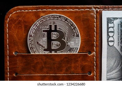 Popular cryptocurrency in leather wallet. Save bitcoins concept. Luxury business stability finance and investment.
