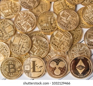 Popular cryptocurrency litecoin, bitcoin, ethereum and ripplecoin on wooden table top