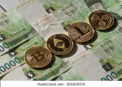 Popular cryptocurrency litecoin, ripple coin, bitcoin and ethereum on South Korean won currency