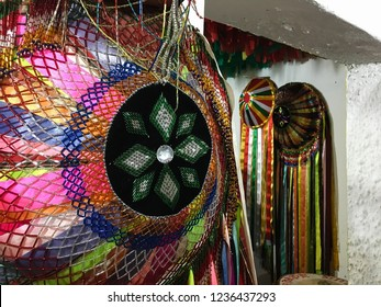Popular culture. Bumba-meu-boi do Maranhão: dance typical of the June festivals. Colorful hats hanging on the wall. Brazil.