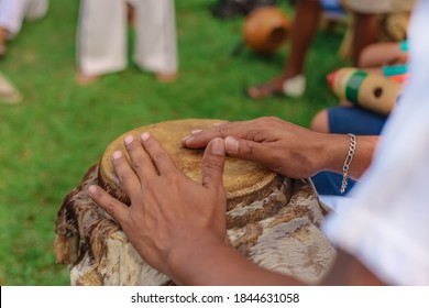 Popular Culture of Capoeira - Close up of hands of man playing African percussive drum