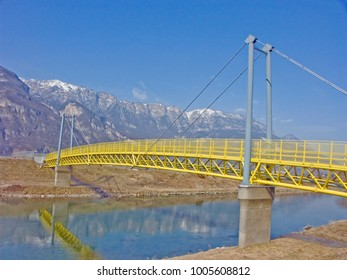 The popular cycle path through South Tyrol and the Adige Valley leads over this yellow, colorful bridge